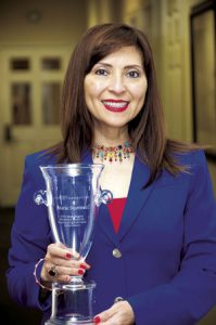 Border FCU CEO Maria Martinez, pictured with her 2017 Herb Wegner Memorial Award for Outstanding Individual Achievement from the National Credit Union Foundation.